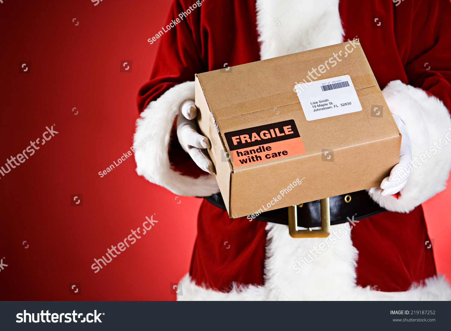 Santa holds shipping box fake address stock photo for Create fake shipping label