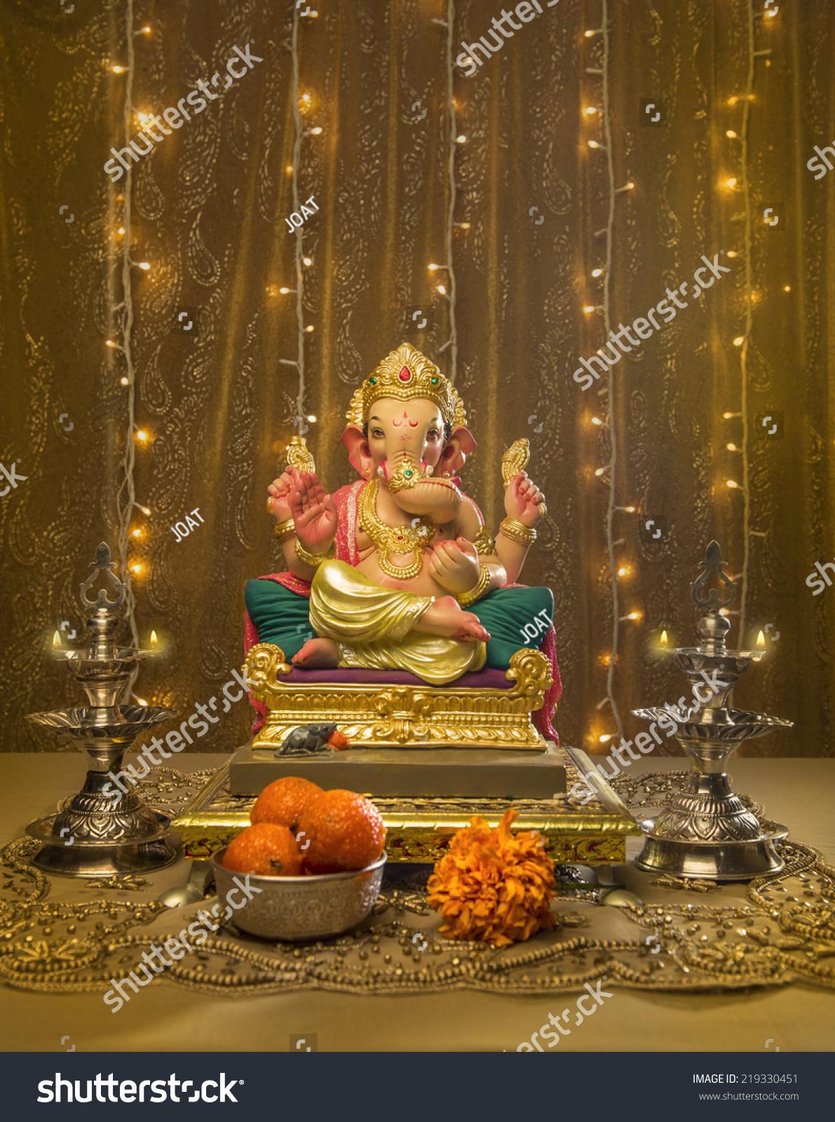 Ganesha idol elaborate indian pooja set stock photo for Background decoration for ganesh festival