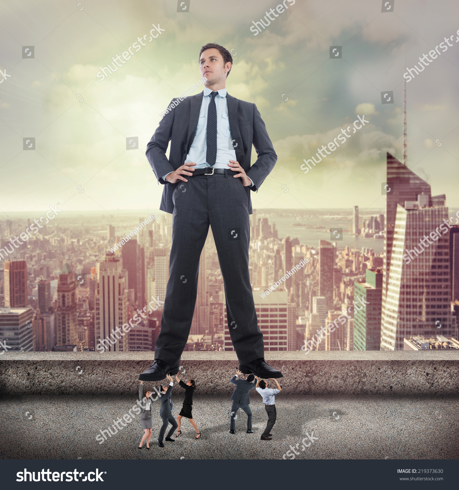 Business team supporting boss against balcony stock photo for Balcony overlooking city
