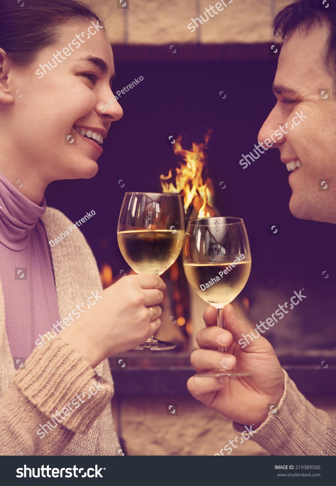 portrait romantic young couple toasting wineglasses stock photo