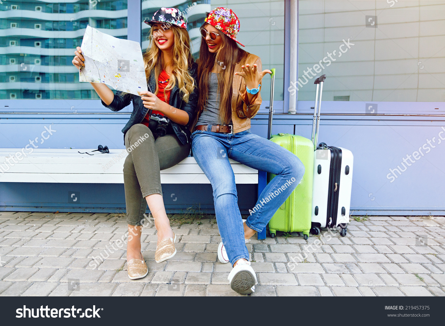 Two young pretty girls exploring and looking on map before their traveling  adventures c78f371094618