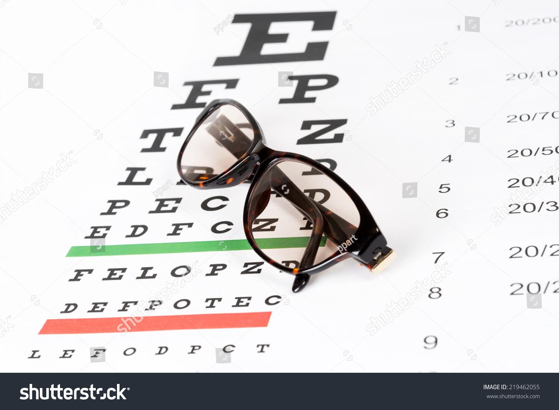 Prescription sunglasses on eye chart background stock photo prescription sunglasses on the eye chart background nvjuhfo Choice Image