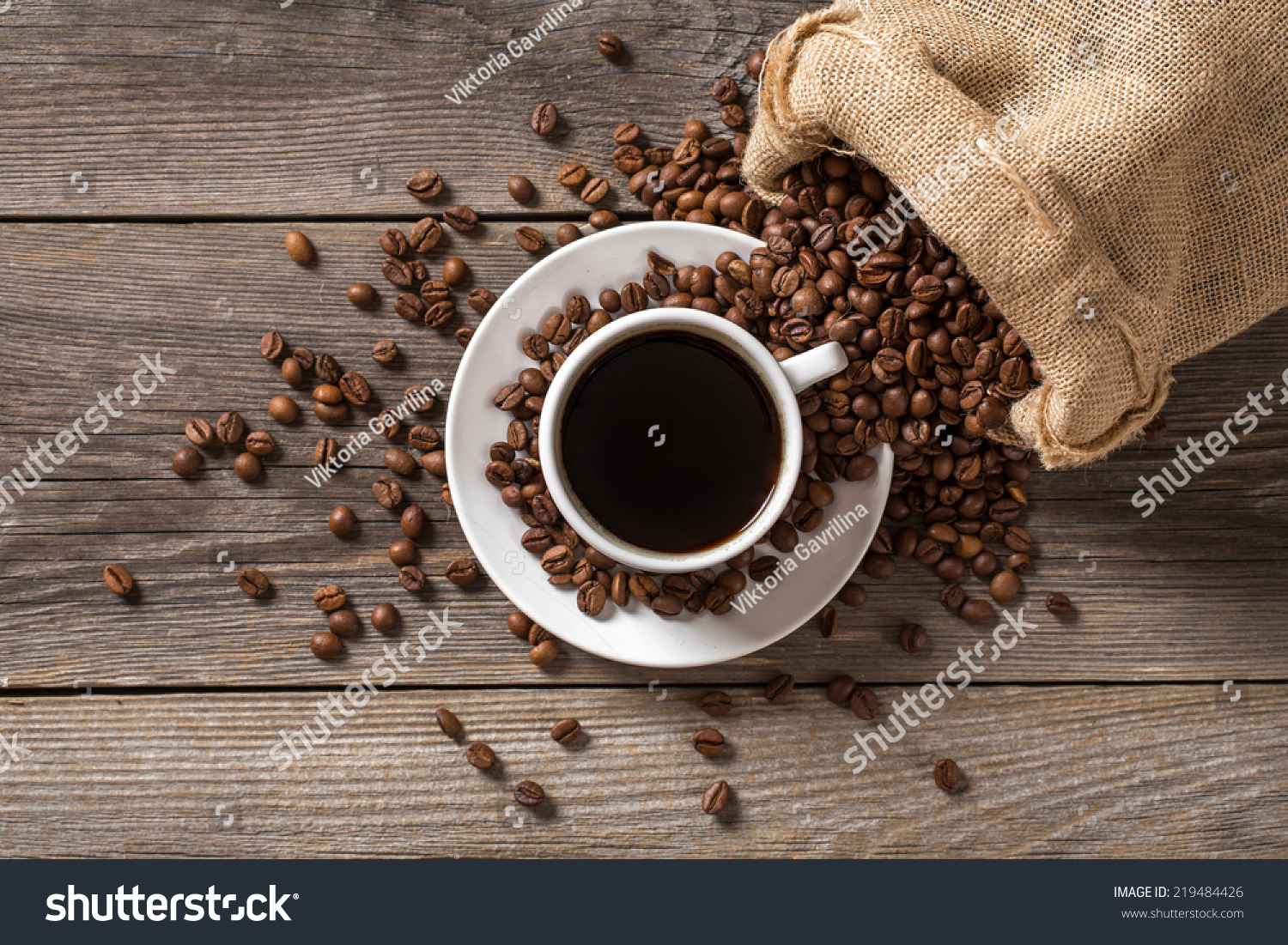 Coffee cup coffee bag on wooden stock photo 219484426 shutterstock coffee cup with coffee bag on wooden table view from top geotapseo Gallery