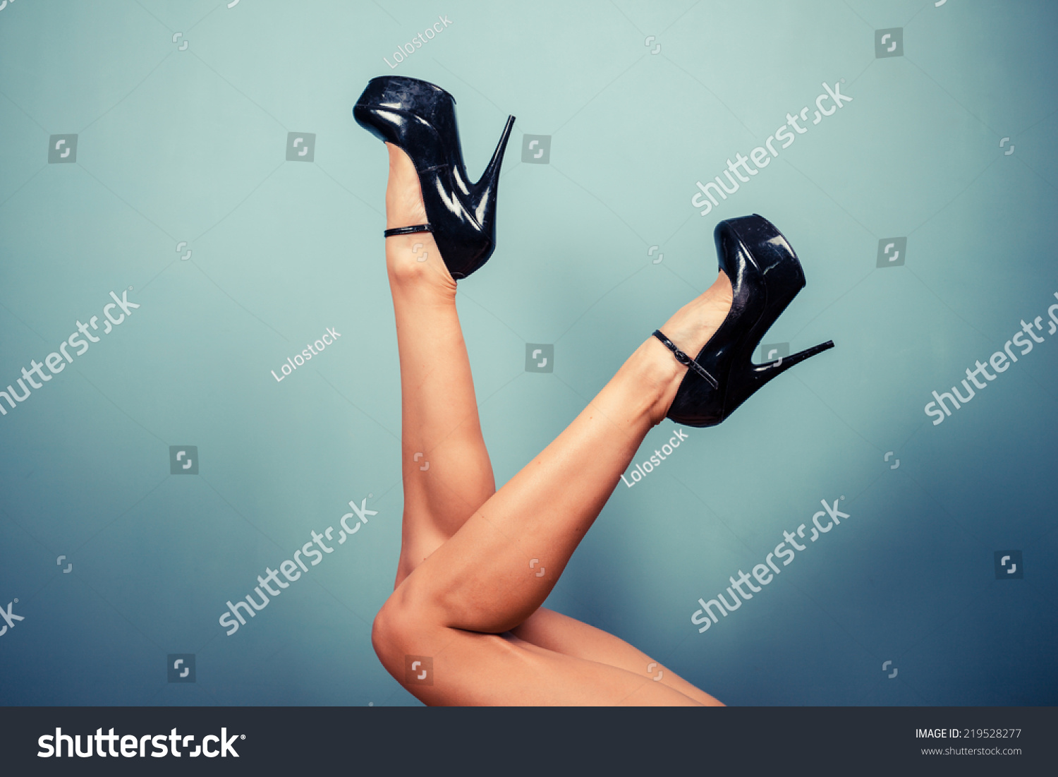 sexy female legs wearing high heels stock photo (royalty free