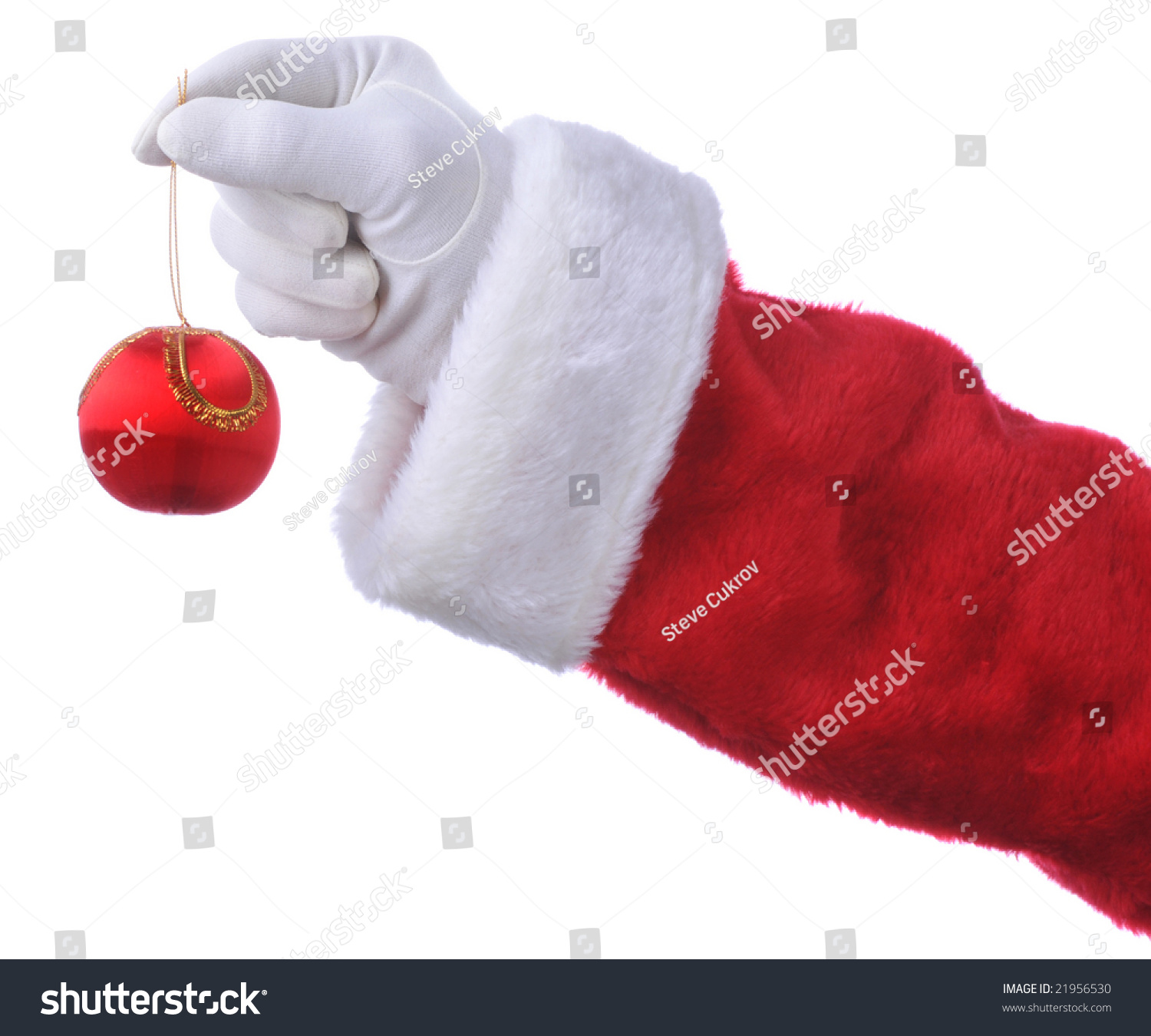 Santa Claus Hand Holding Gingerbread Man Over A White Vackground ...
