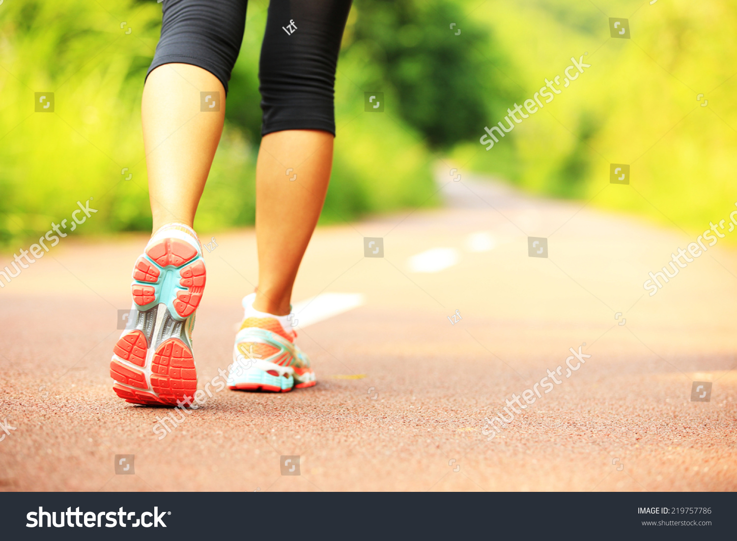 young fitness woman hiker legs  at forest trail  #219757786