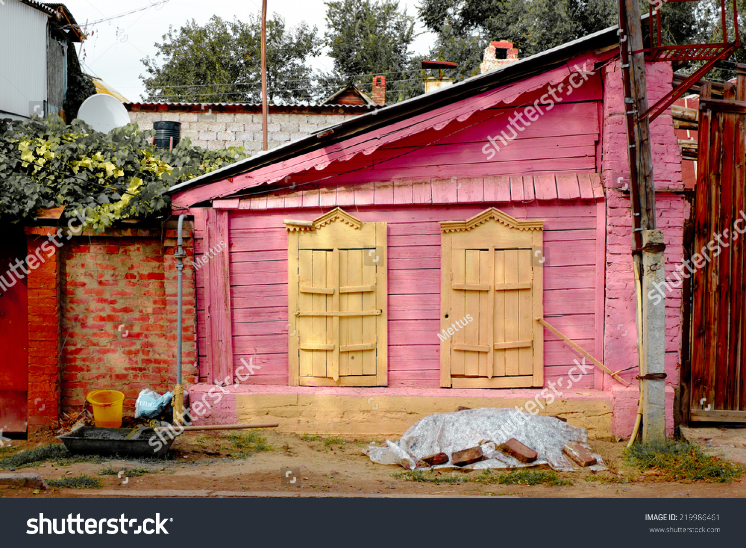 stock-photo-old-painted-in-pink-with-yel