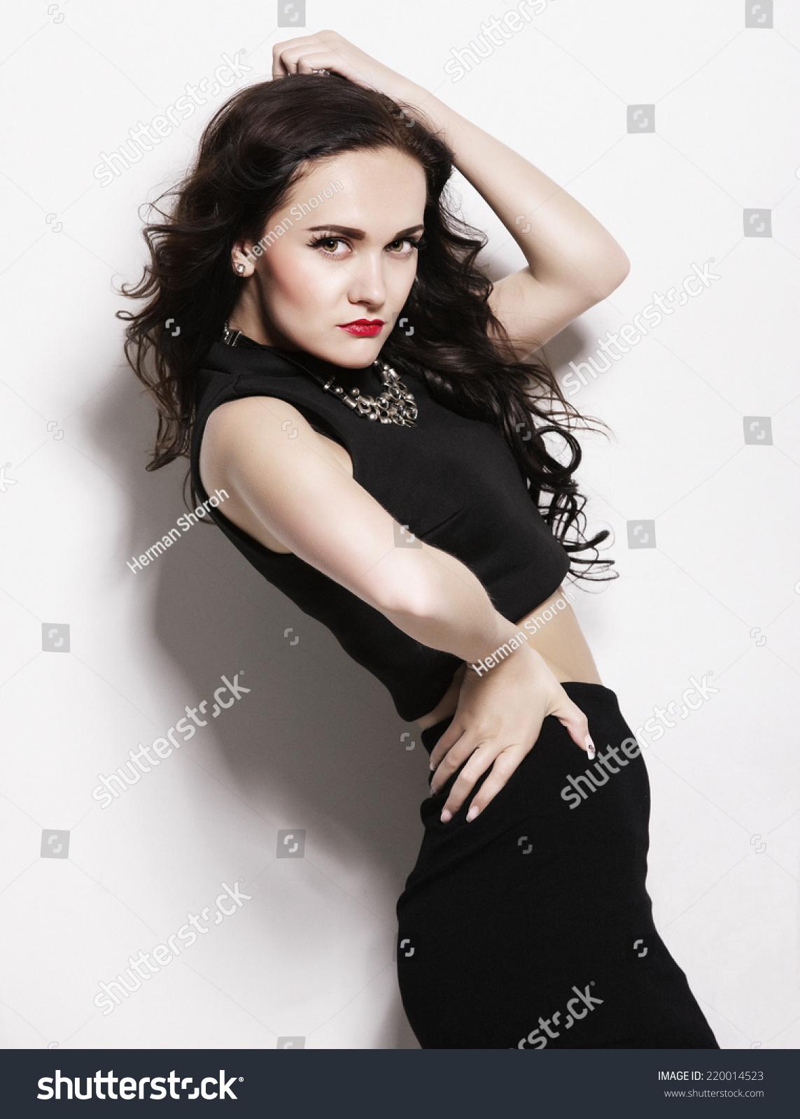 Fashion girl model posing on white background in the studio. Always more on  my portfolio