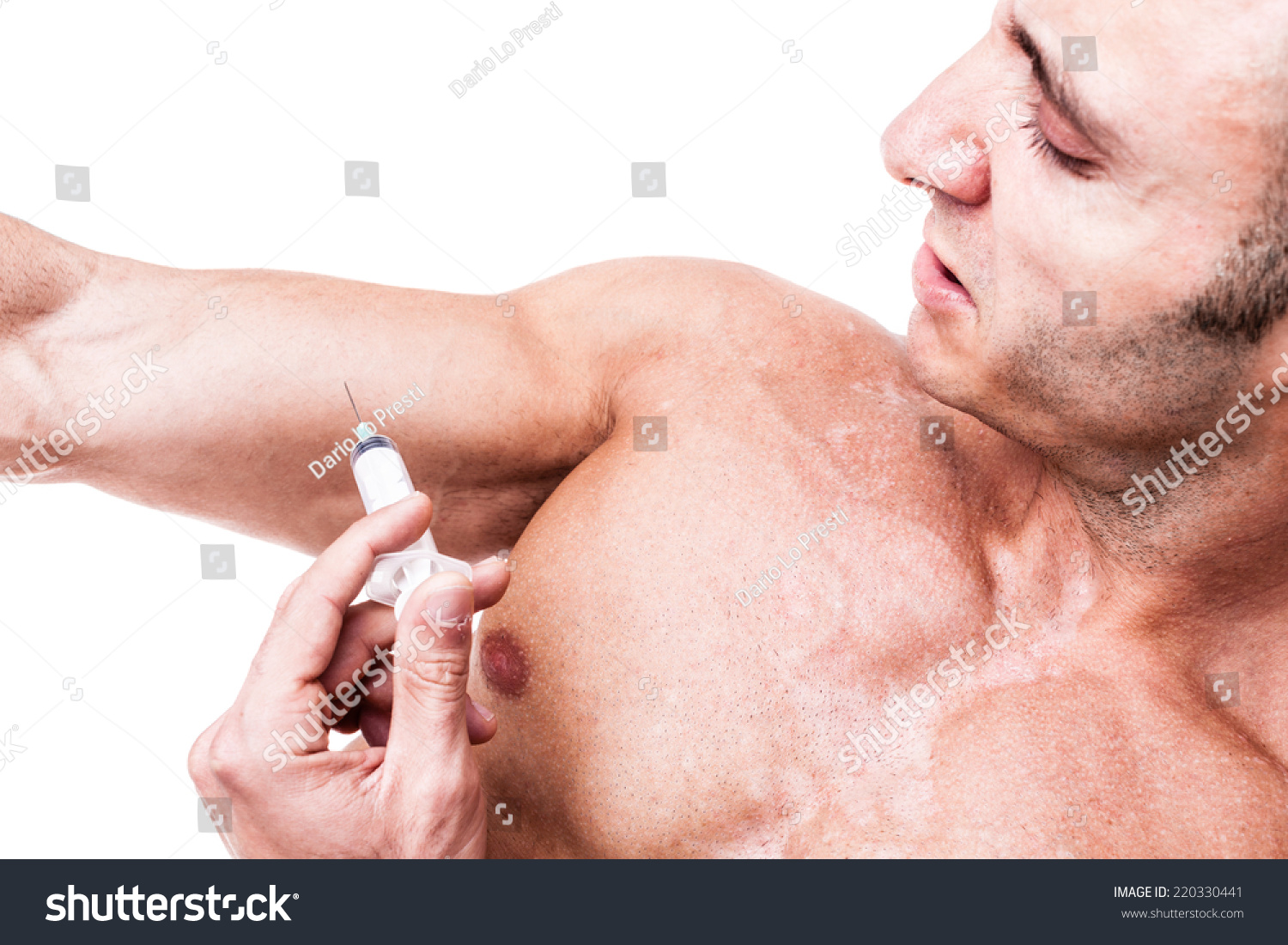 A Muscular Man Giving Himself A Steroid Injection In His