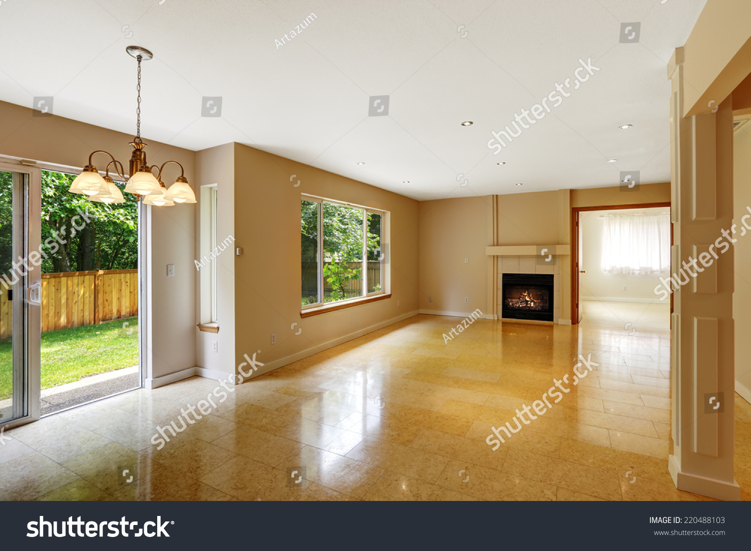 Empty living room shiny marble tile stock photo 220488103 empty living room with shiny marble tile floor and fireplace room has exit to backyard doublecrazyfo Image collections