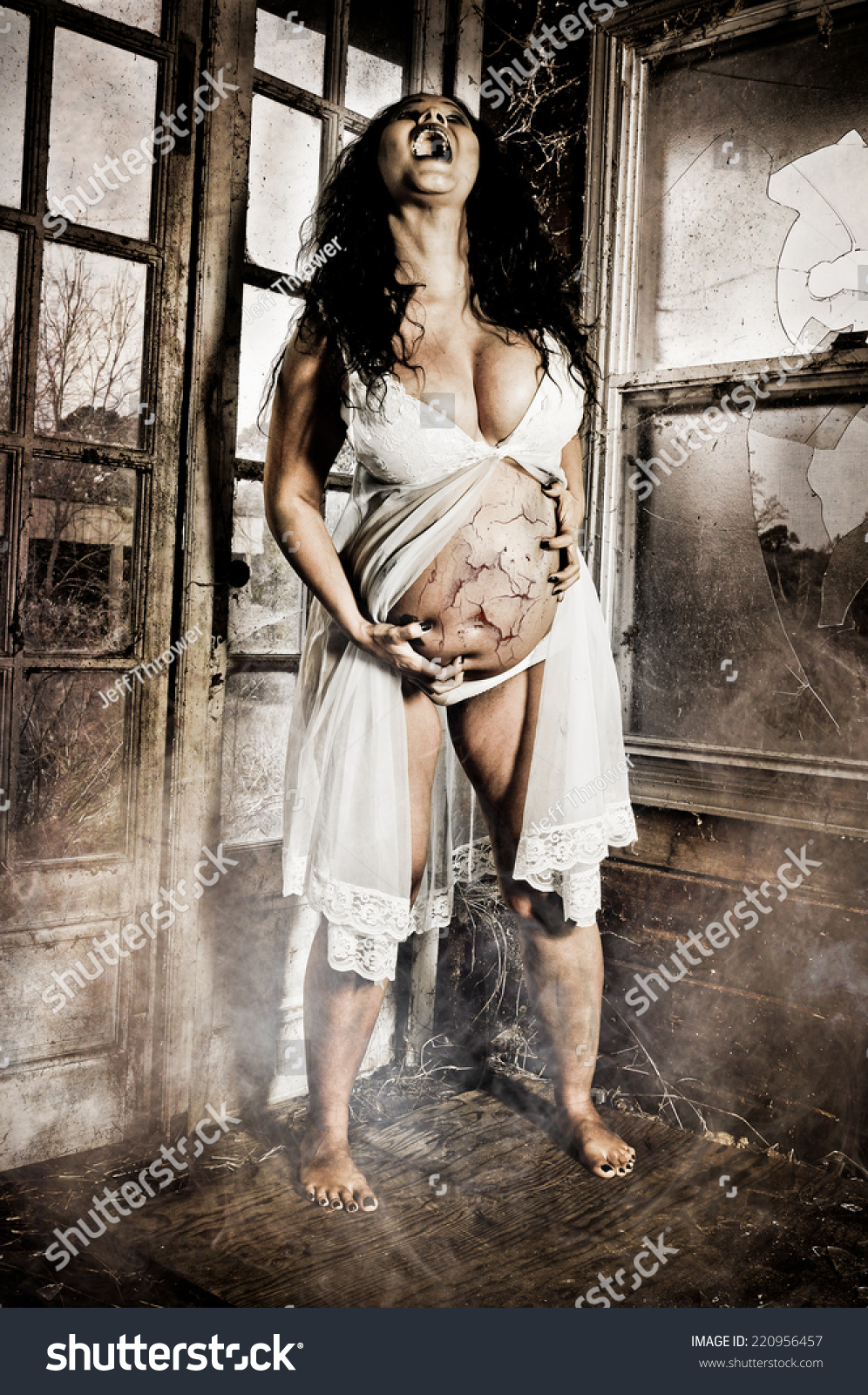 pregnant voyeur -porn Horror Scene of a Pregnant Woman Possessed with cracked skin holding her  belly