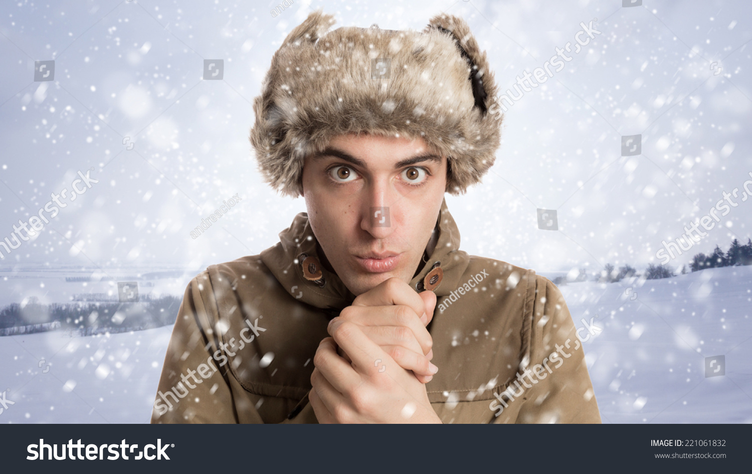 0c0b2565528 Portrait of young man with eskimo hat and winter background with snow
