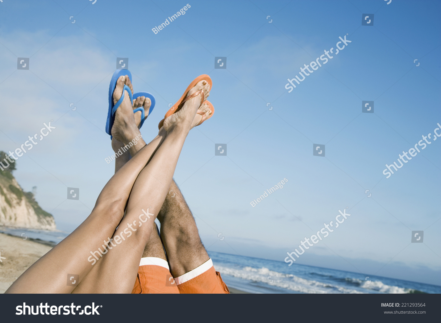 Multi-ethnic couple with feet in air #221293564