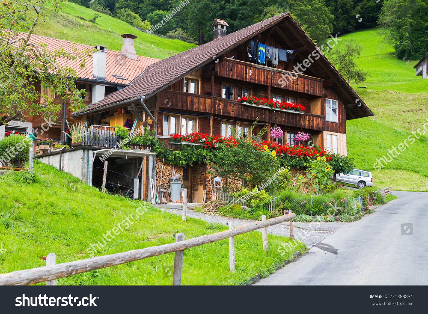 Typical swiss wood house decorations flowers stock photo for Swiss homes