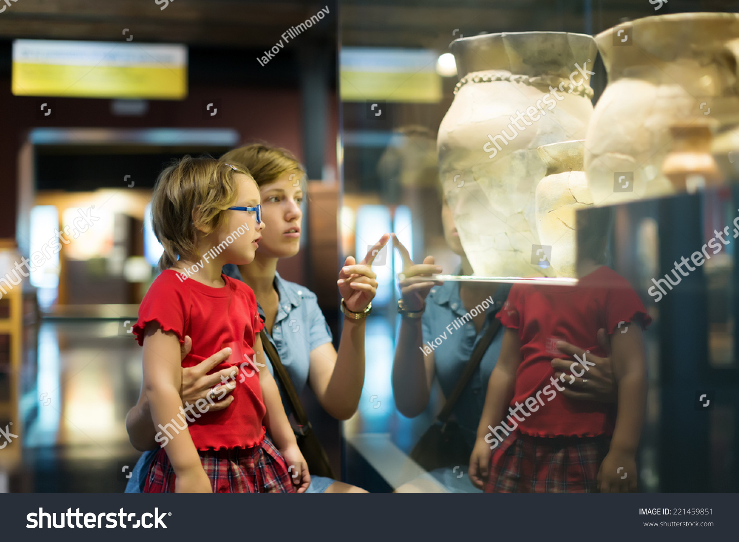 mother and child looking ancient amphores in  museum #221459851