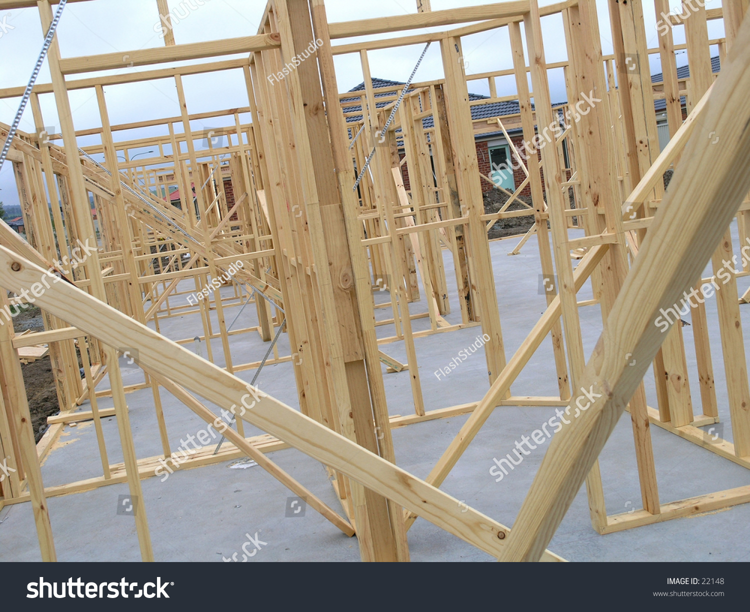 House construction at frame stage bare studs stock for Stages of home construction