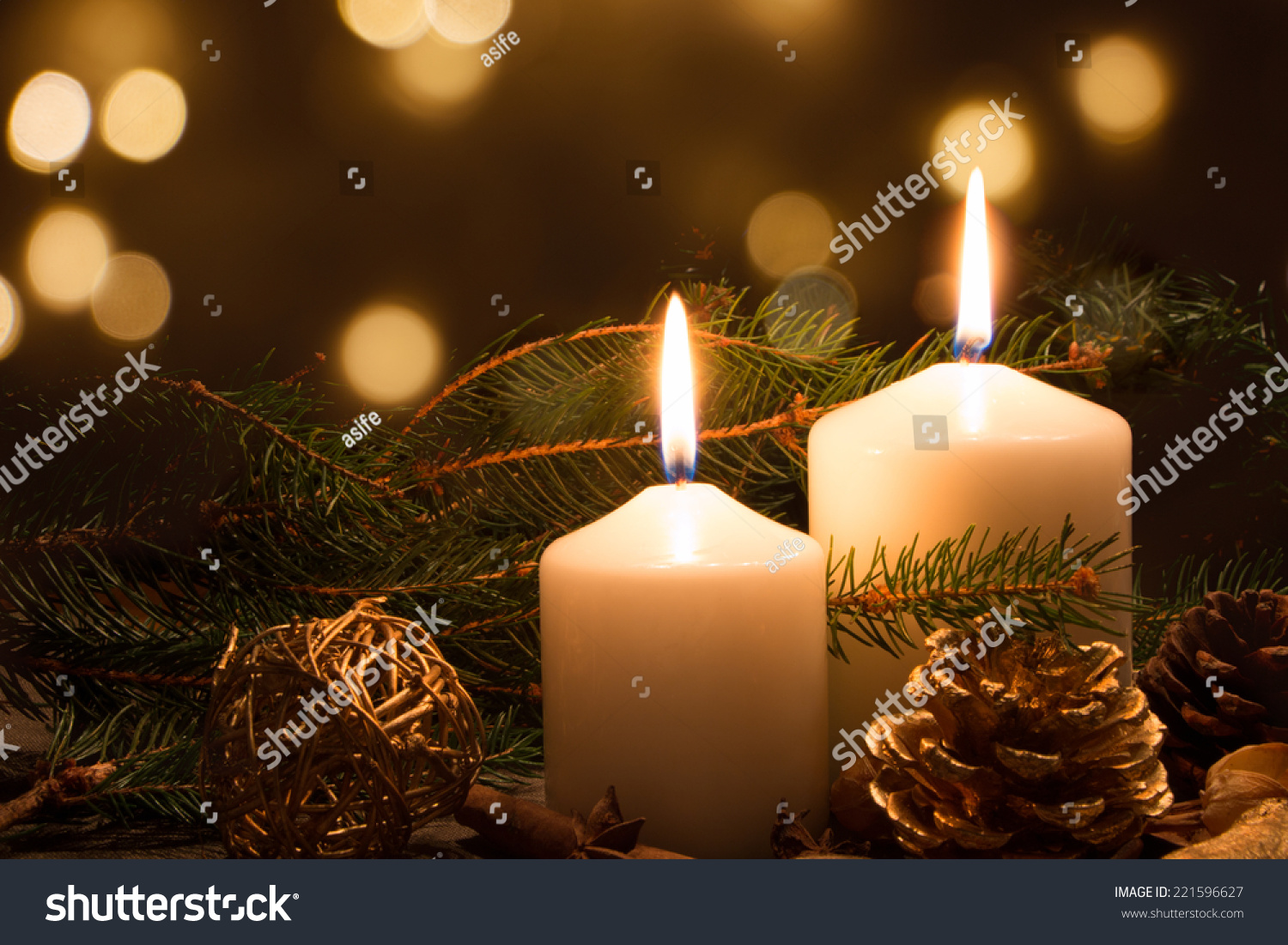 Christmas candles and ornaments over dark background with for Christmas candles and ornaments