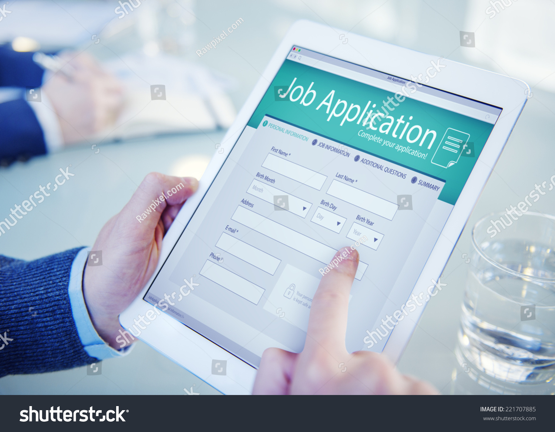applicant filling online job application stock photo  applicant filling up the online job application