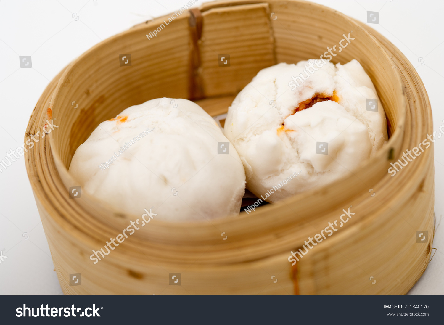 royalty free steamed chinese bun in bamboo basket 221840170 stock