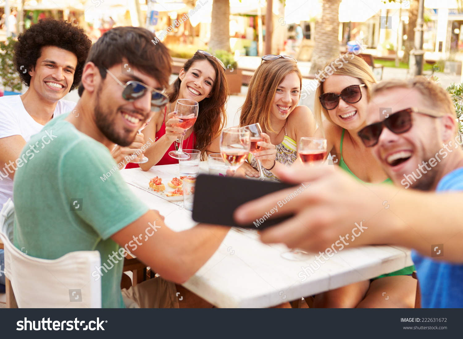 Group friends taking selfie during lunch stock photo for Group lunch