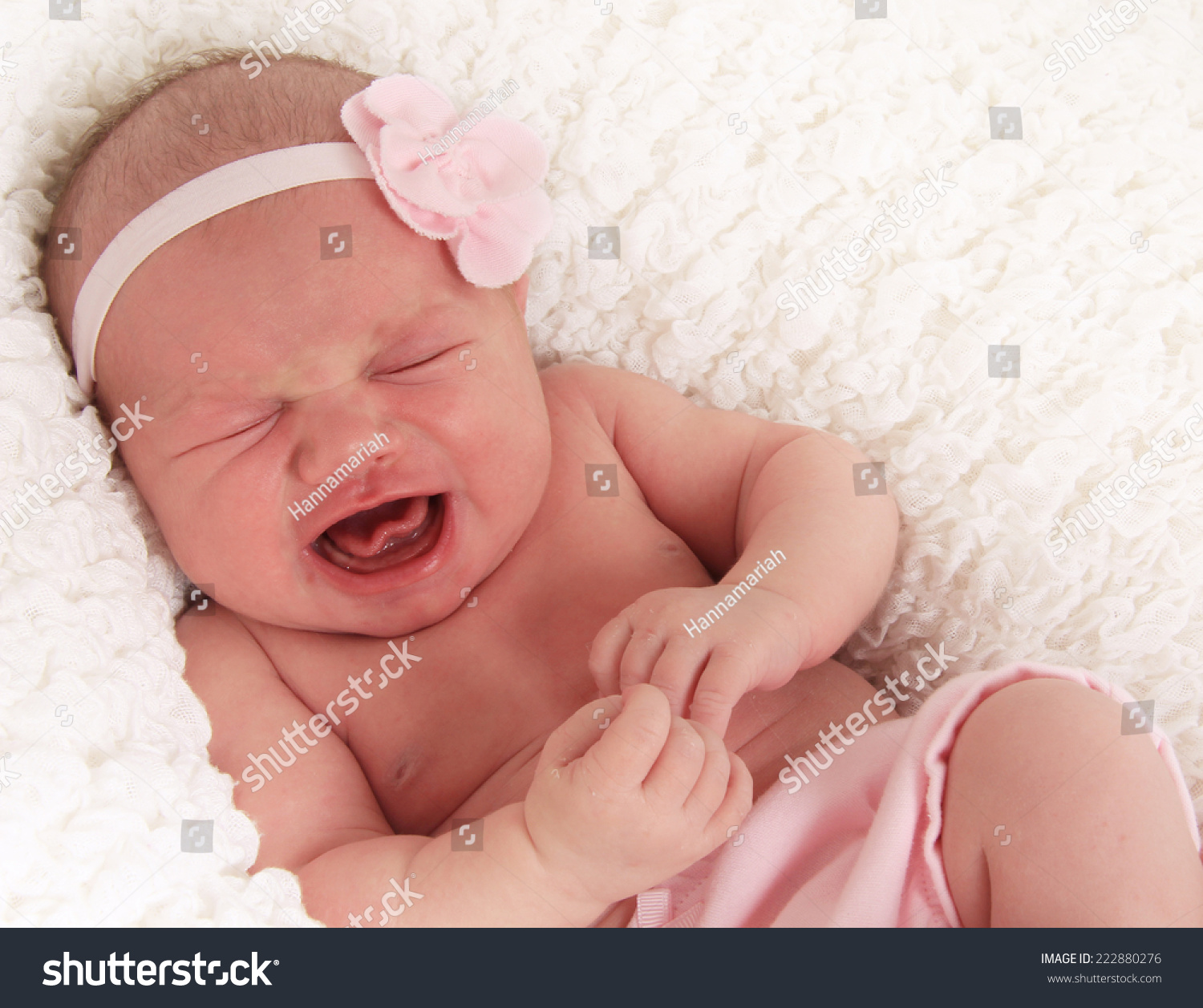 One week old newborn baby girl crying loudly