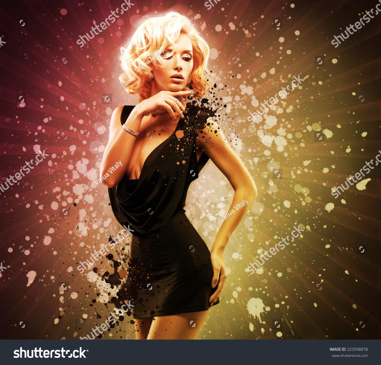 Beautiful sexy woman in black dress posing at creative art for Beautiful creative art