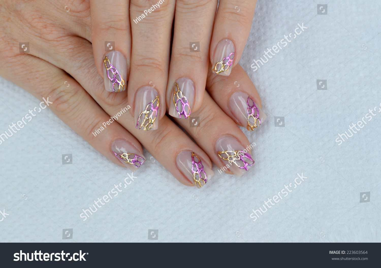 Beautiful natural nude nail art design stock photo 223603564 beautiful natural nude nail art design with gold and pink transfer foils prinsesfo Gallery
