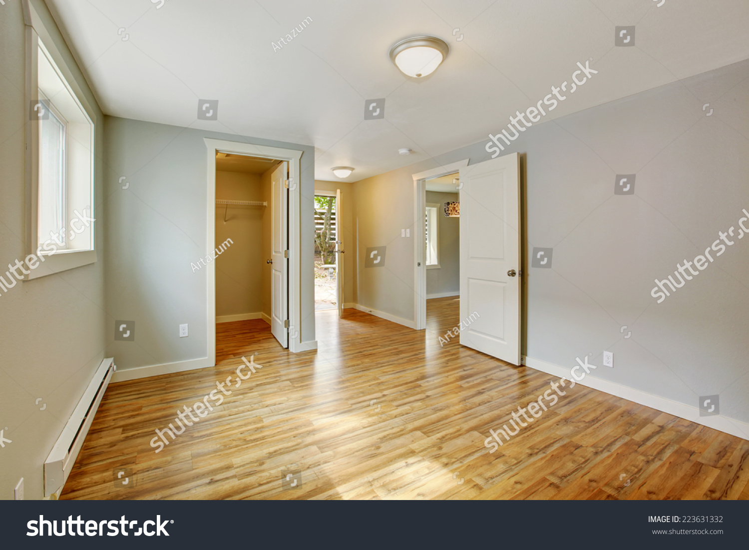 empty walk in closet. Empty House Interior. Bedroom With Walk In Closet And Exit To Backyard Area
