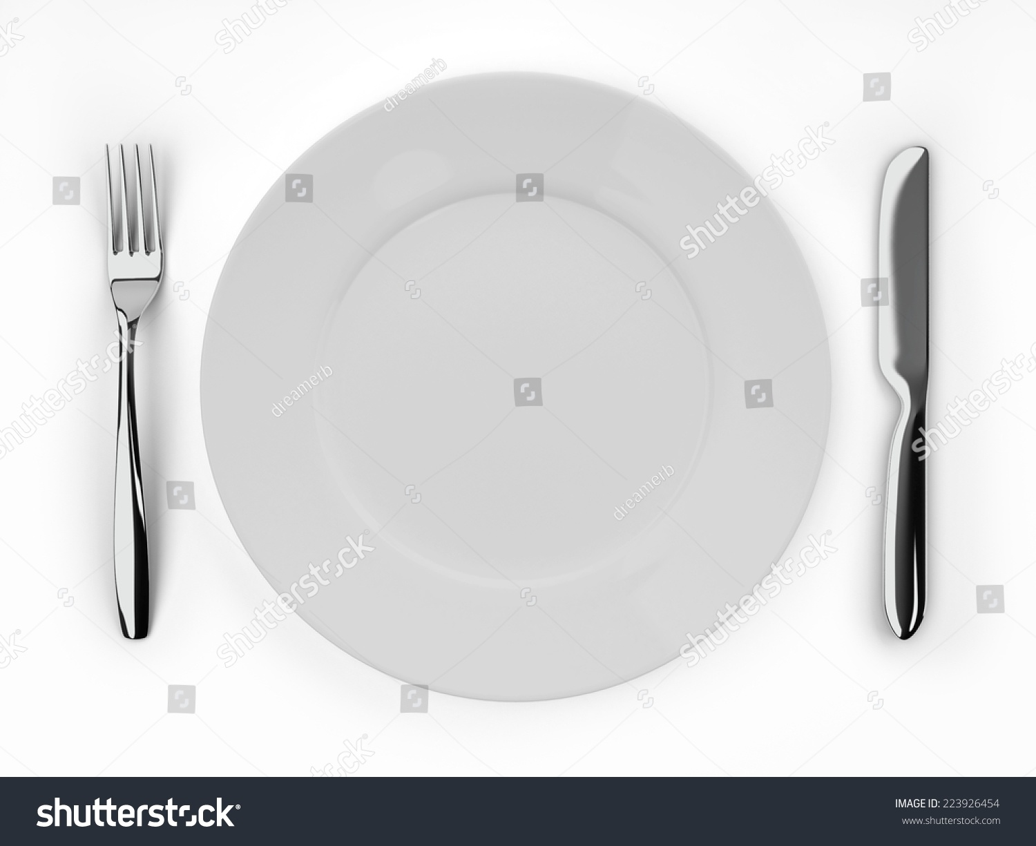 An empty white dish with knife and fork on a table - Empty Dinner Plate Knife And Fork