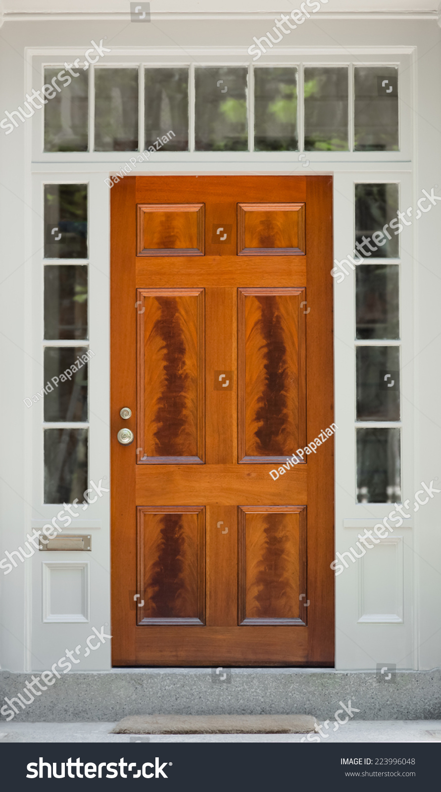 Natural Wood Front Door With White Door Frame And Windows