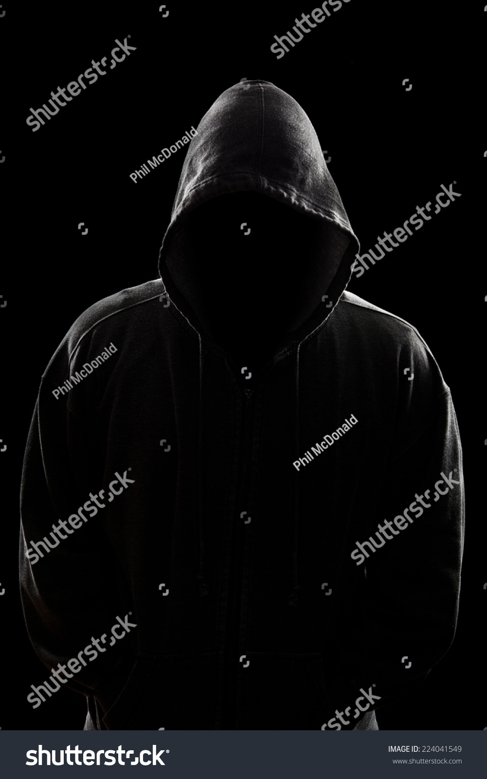 A Dark, Sinister Figure In A Hooded Sweatshirt. Stock ...