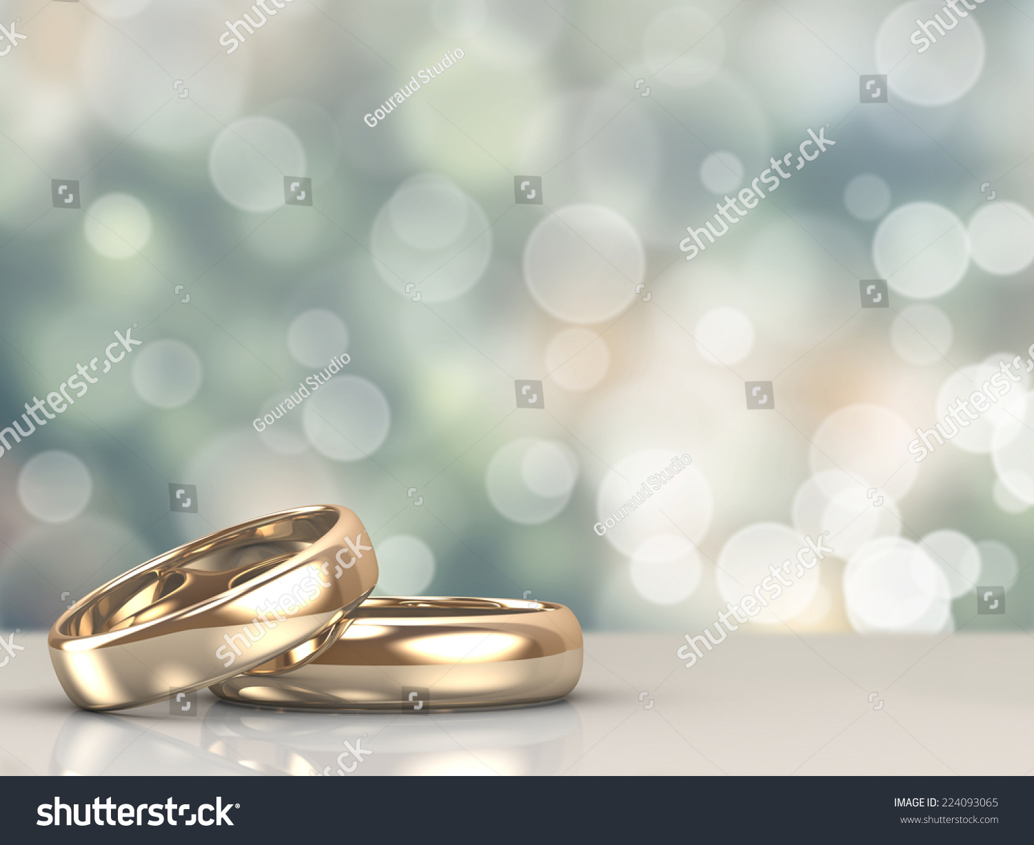 A Pair Of Gold Wedding Rings With Bokeh Background Stock ...