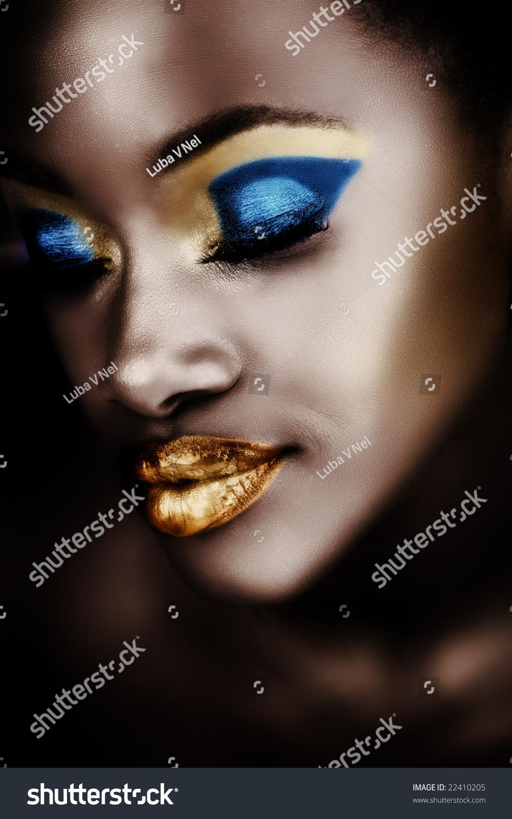 African Woman Gold Blue Metallic Makeup Stock Photo