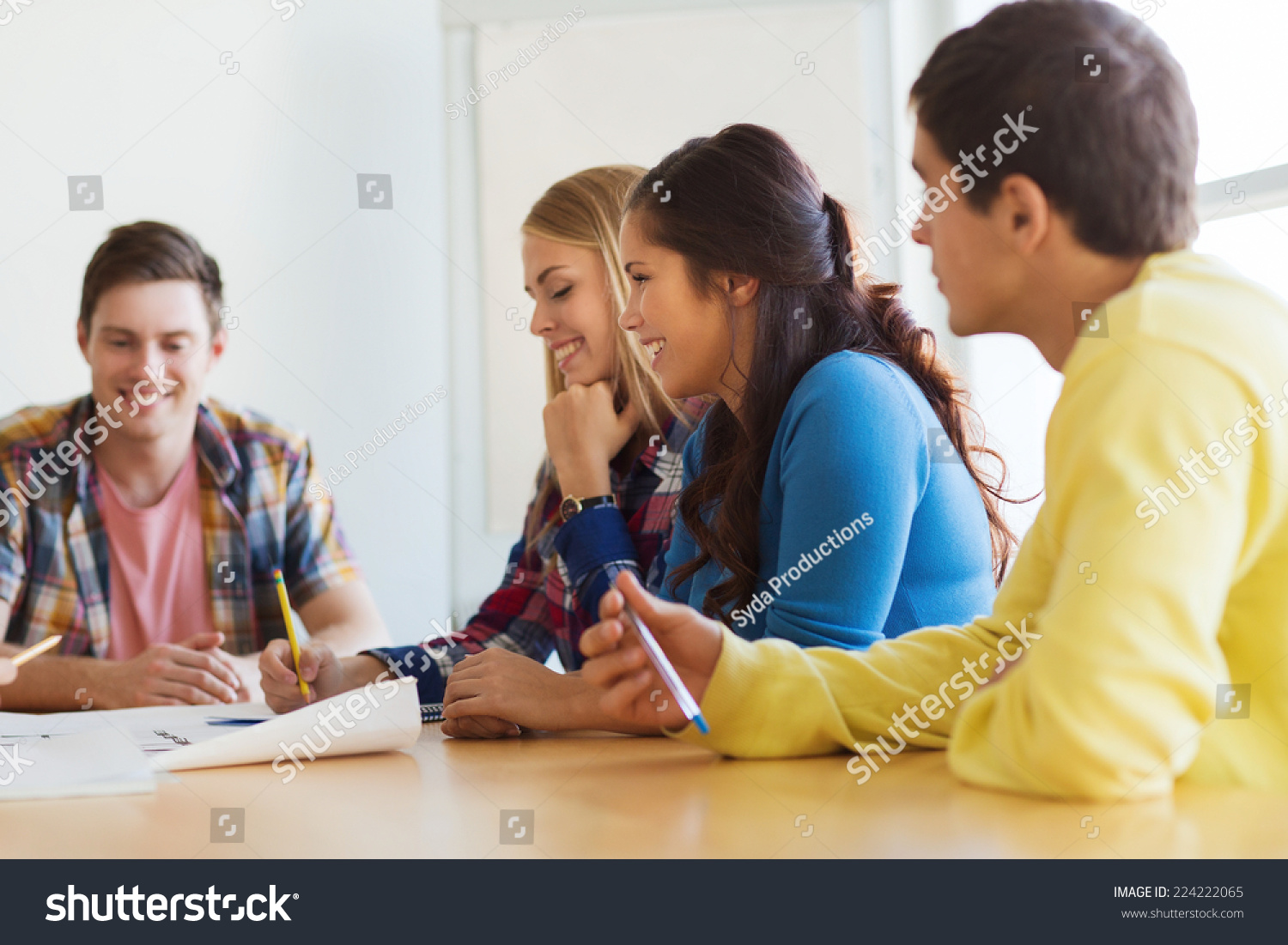 Startup education architecture office concept smiling stock photo startup education architecture and office concept smiling architects with house model and blueprint malvernweather Choice Image