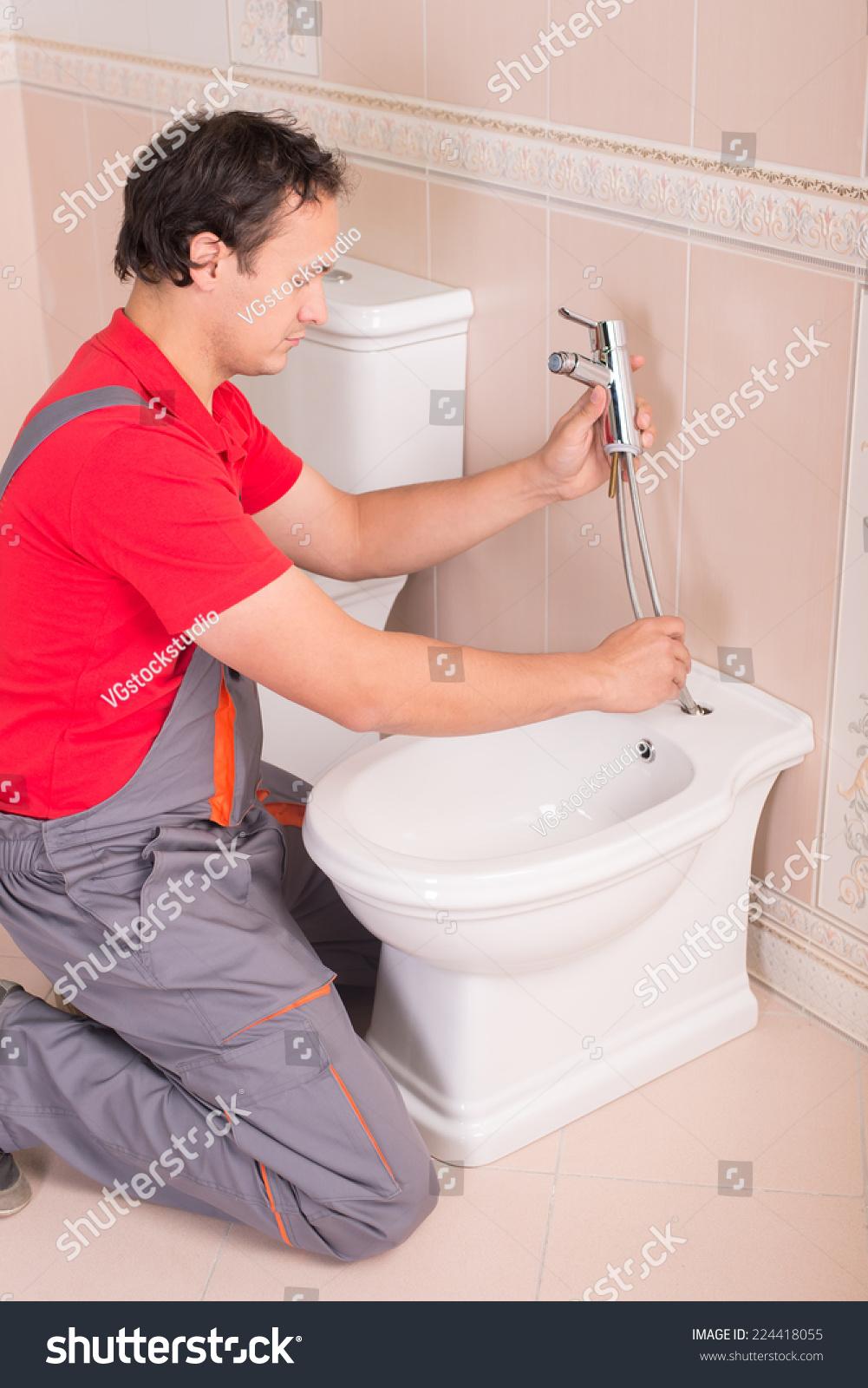 Plumber During His Work Toilet Stock Photo & Image (Royalty-Free ...