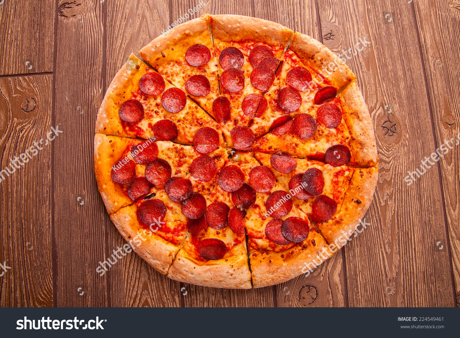 Pizza on wooden table stock photo 224549461 shutterstock for Table a pizza