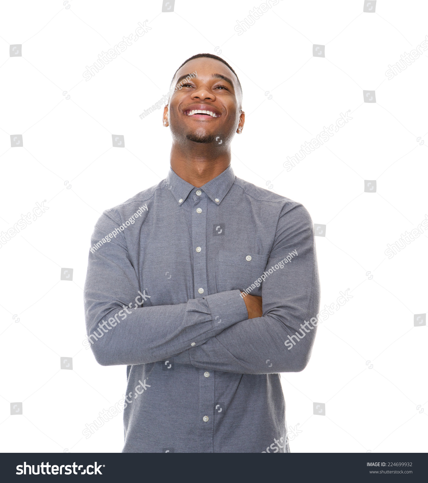 0e00787a5ba Close up portrait of a laughing young black man with arms crossed on  isolated white background