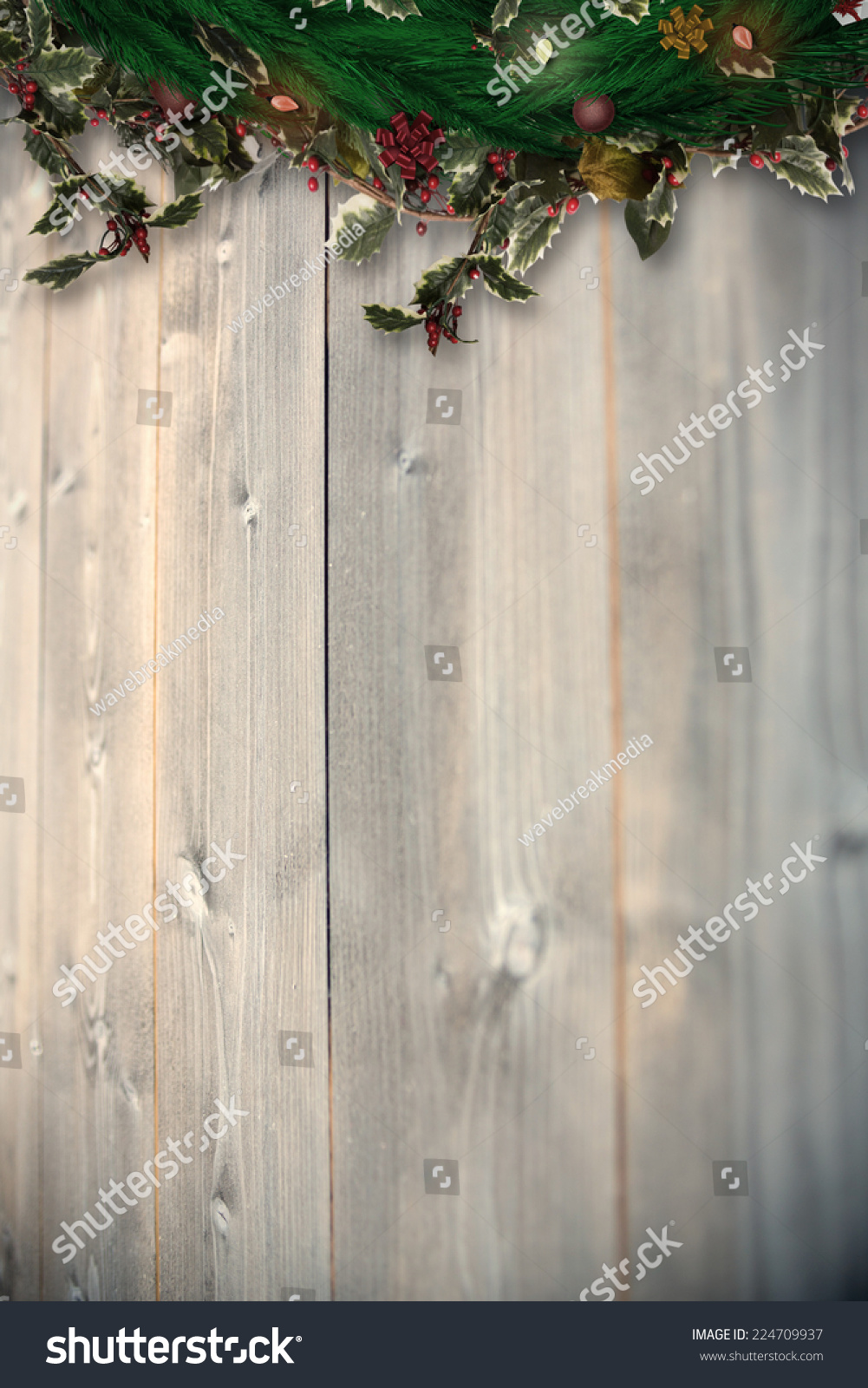 Festive christmas wreath with decorations against bleached wooden planks background #224709937