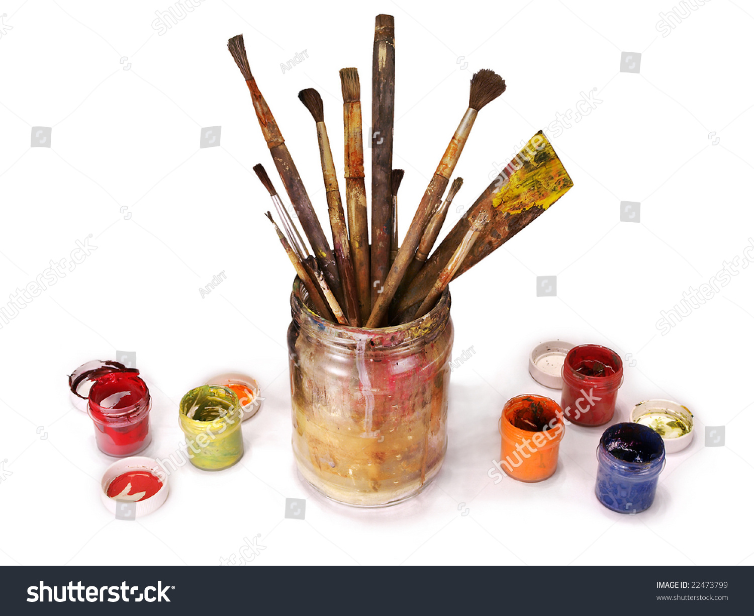 paint brushes in jar. old paint brushes in a glass jar with dried