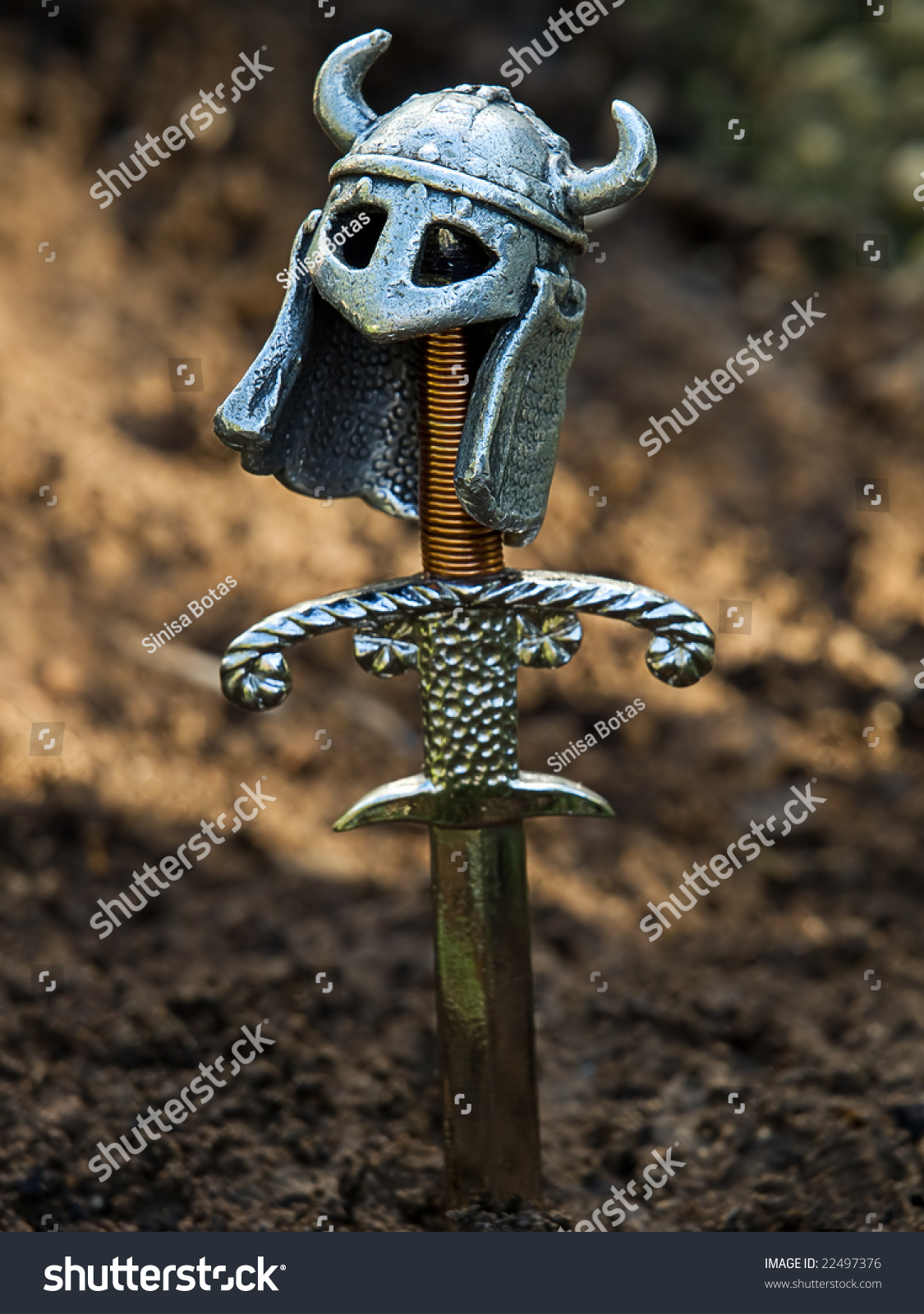 Warrior's grave with a sword and helmet instead of the cross.