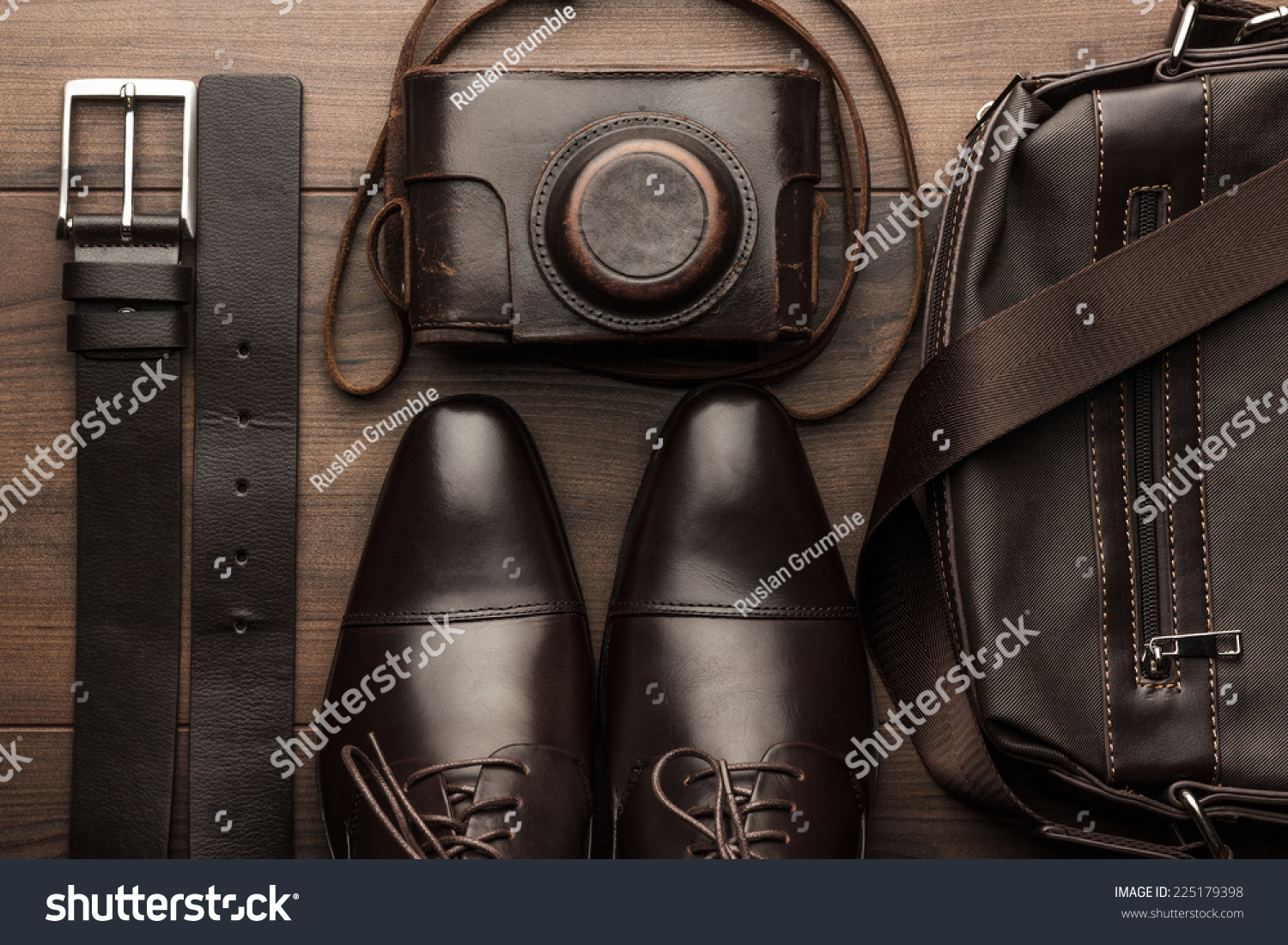brown shoes belt bag and on the wooden table