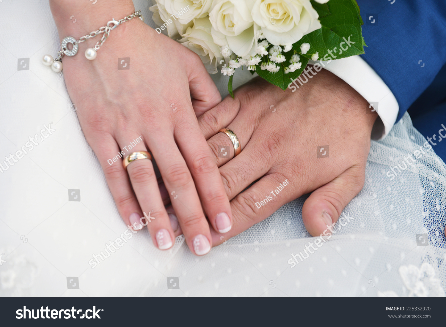 Royalty-free Two hands with wedding rings and flowers #225332920 ...