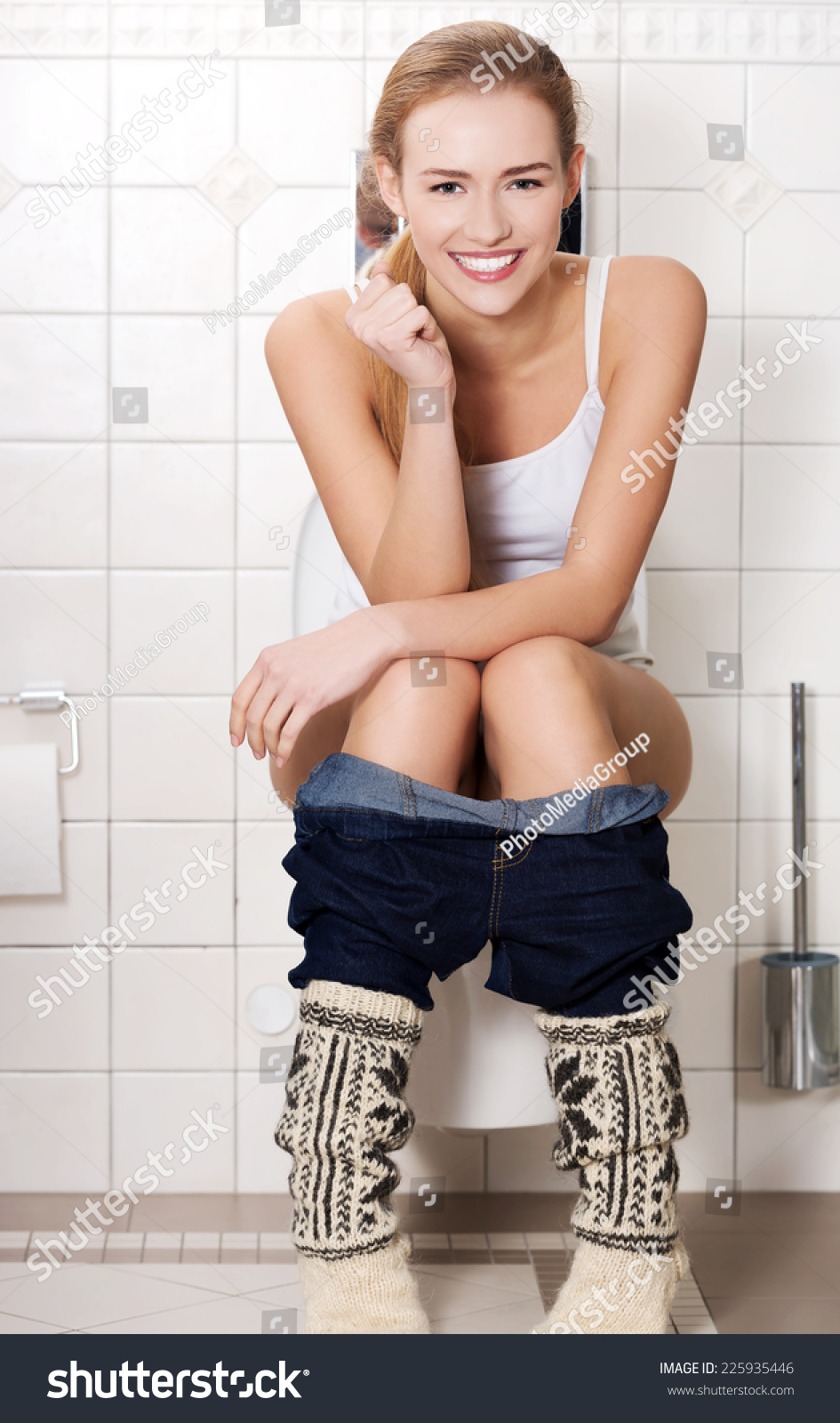 Young Woman Sitting On Toilet High-Res Stock Photo - Getty