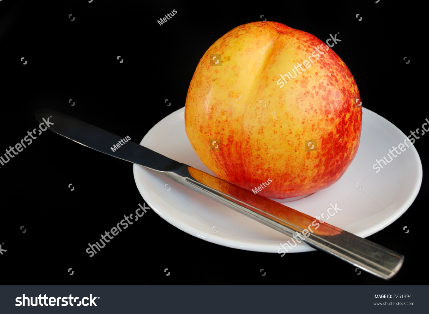 stock-photo-fresh-peach-on-white-saucer-