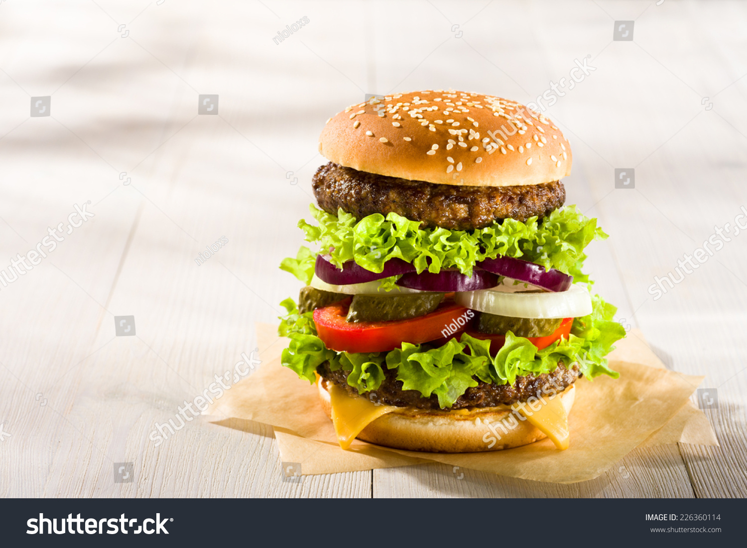 Homemade burger on wooden table stock photo 226360114 for Table burger