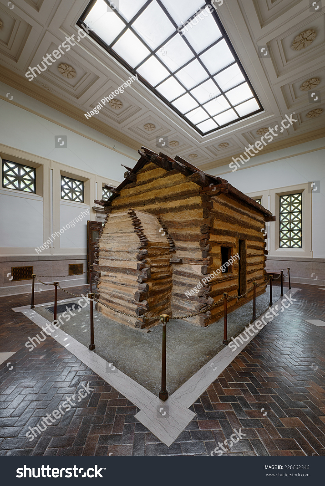 Very Impressive portraiture of   OCT 21: Log cabin inside the first Lincoln Memorial building  with #604933 color and 1071x1600 pixels