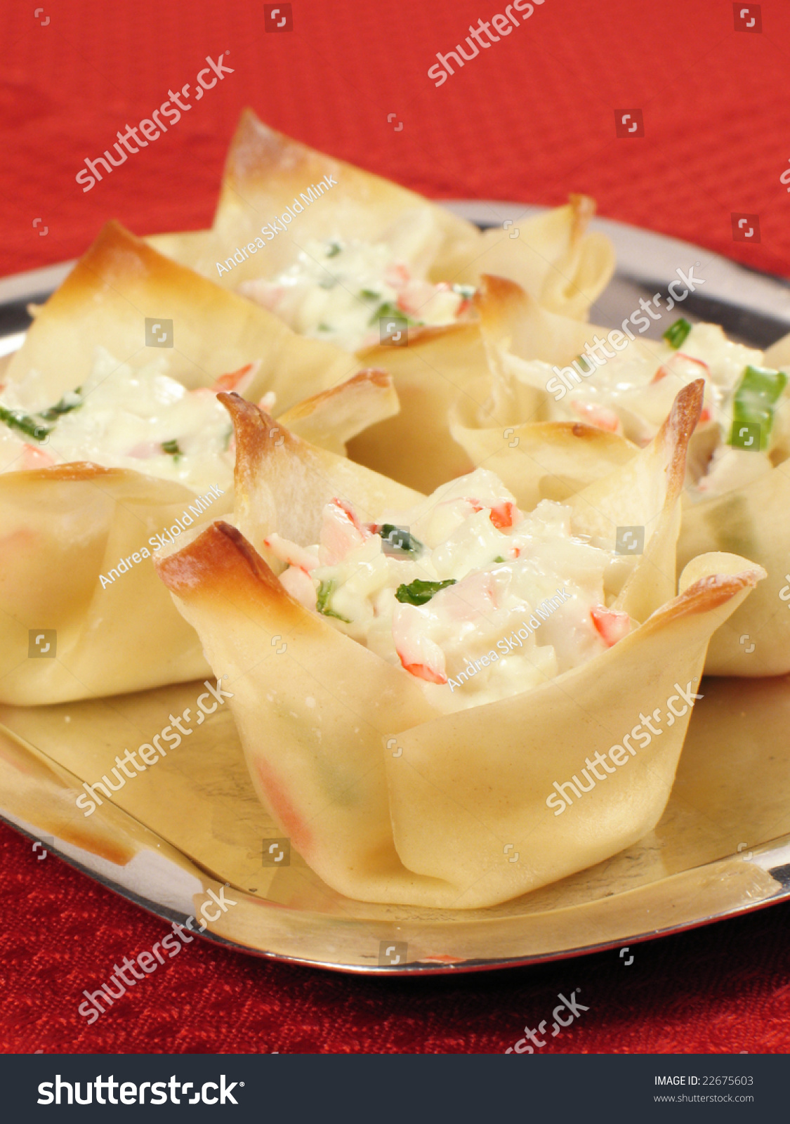 Baked wonton wrappers filled with crab meat, cream cheese, and green ...