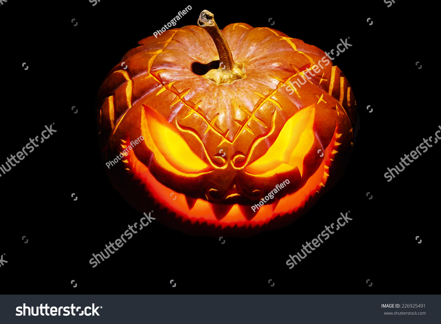 scary halloween pumpkin with burning eyes, isolated on black | ez canvas