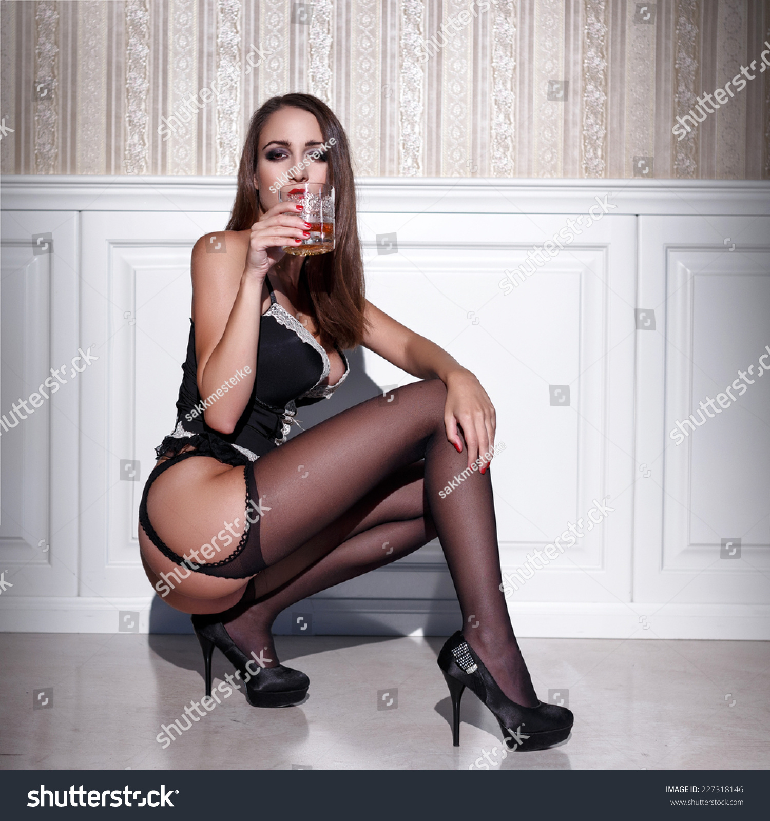 Sexy Woman Corset Stockings Squat Whiskey Stock Photo Edit Now 227318146