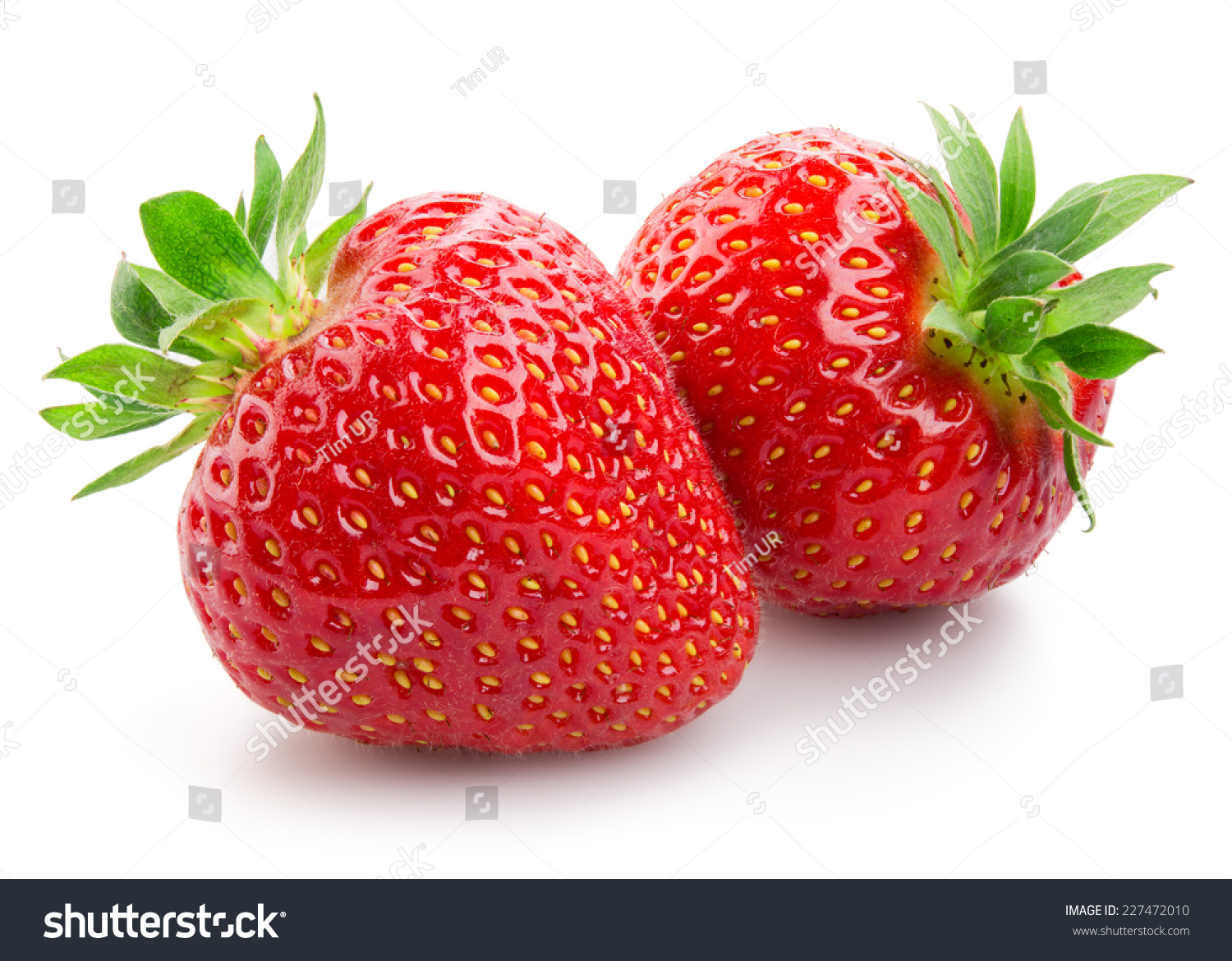 Two Strawberries Close Up On White Background Stock Photo ...